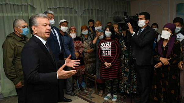 Uzbekistan's President Shavkat Mirziyoev meets with evacuees on May 2, 2020.