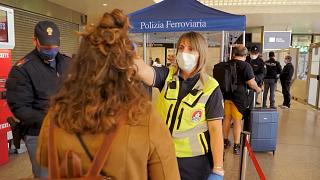 Coronavirus: Face masks to the fore as Rome's transport network stirs into life