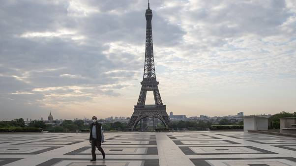 A man wears a mask to protect against the spread of the coronavirus as he walks along the Trocadero square close to the Eiffel Tower in Paris