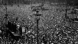 Huge crowds cram into Whitehall and Parliament Square, central London, to hear Prime Minister Winston Churchill announce the end of the war in Europe. May 8, 1945.