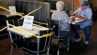 Tables are taped off to promote social distancing at Falcone's Pizzeria in Oklahoma City, as restaurants are allowed to open for in person dining