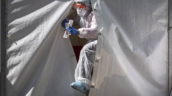 A medical staff gets out from a tent of a testing point for the COVID-19 coronavirus in central Moscow