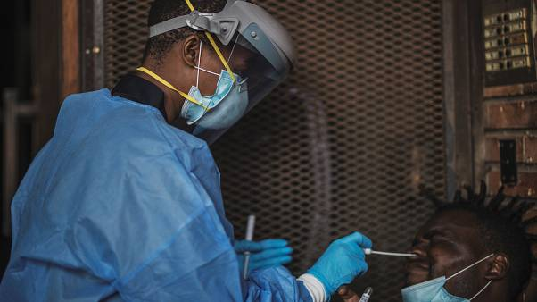 A Gauteng Health Department Official collects samples from a man