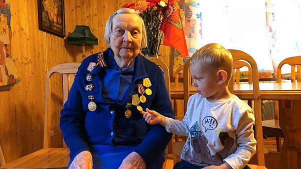 Zinaida Korneva, World War II veteran with her great-great grandchild Richard Panov in St. Petersburg, Russia, Tuesday, May 5, 2020.