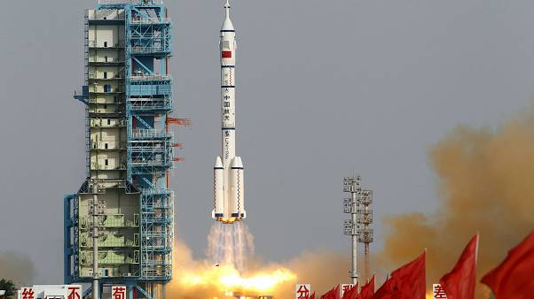 FILE: In this file photo taken Saturday, June 16, 2012, a Shenzhou 9 spacecraft Long March rocket with 3 astronauts including China's first female astronaut launches