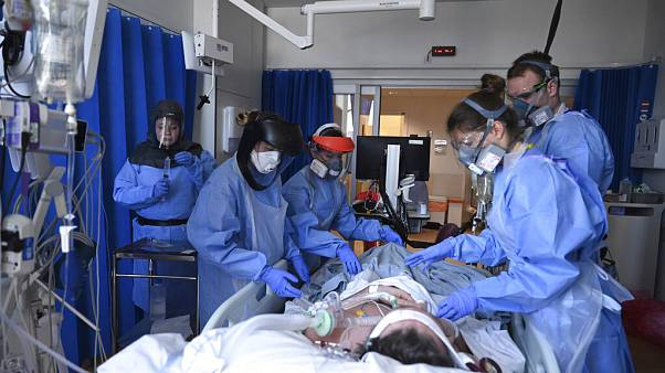 Members of clinical staff care for a patient with coronavirus in the intensive care unit at the Royal Papworth Hospital in Cambridge, UK, Tuesday May 5, 2020