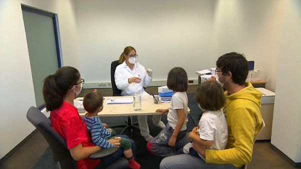 Family in testing room at Schwechat Airport, Austria