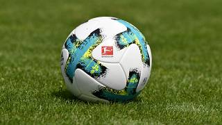 In this file photo taken on August 01, 2017 a ball with the logo of the German first division football league Bundesliga is seen on the pitch