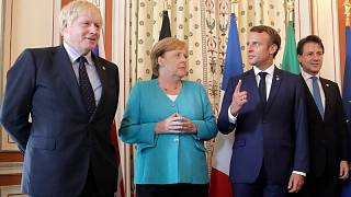 Macron gestures upwards, not unlike his approval rating during COVID-19 pandemic