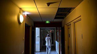 A patient walks in a corridor of the  Clos Benard psychiatric hospital in Aubervilliers,