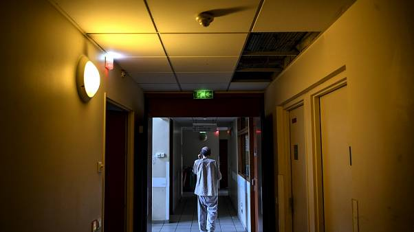 A patient walks in a corridor of the  Clos Benard psychiatric hospital in Aubervilliers,