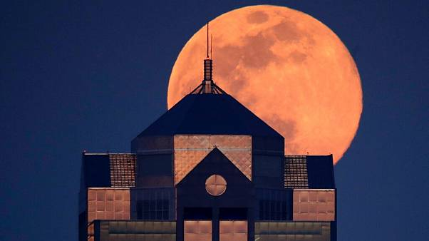 Last month's supermoon rising behind a downtown office building in Kansas City, Mo., Tuesday, April 7, 2020.