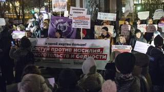 People hold banners against domestic violence attend a rally in Moscow's downtown, R on Monday, Nov. 25, 2019.ussia