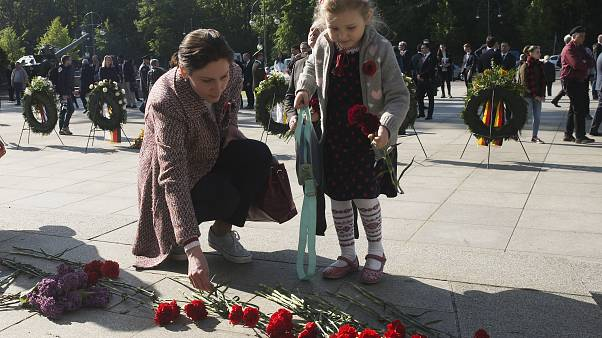 Four-year-old Emilia lays down flowers at Berlin's Soviet War memorial during commemorations to mark the 75th anniversary of Victory Day on May 8, 2020.