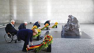 German Chancellor Angela Merkel and other officials lay wreaths at the Neue Wache Memorial in Berlin, Germany, May 8, 2020.