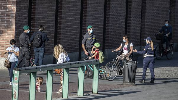 Extra police officers patrol Europe's streets and beaches as lockdown restrictions ease