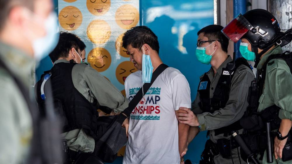Police chase Hong Kong Mother's Day protesters