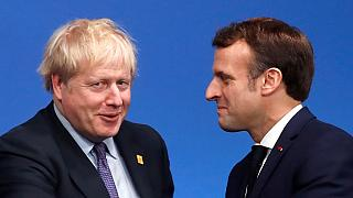 Britain's Prime Minister Boris Johnson (L) welcomes France's President Emmanuel Macron (R) London on December 4, 2019. (Photo by CHRISTIAN HARTMANN / POOL / AFP)