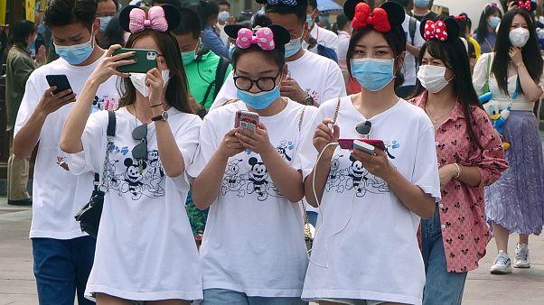APTOPIX Virus Outbreak China Disneyland