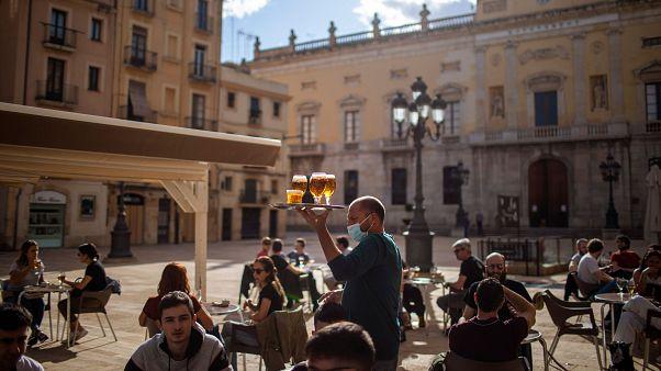 People enjoy drinks in Tarragona, Spain