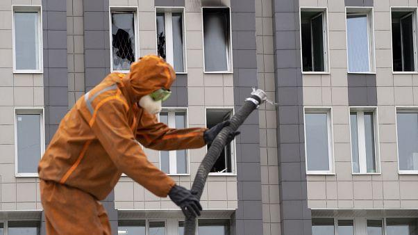 Virus Outbreak Russia Fire
