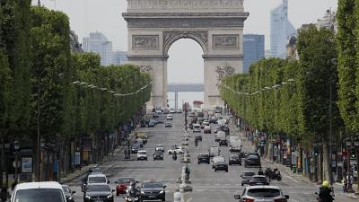 Cars drive on the Champs Elysee avenue, Thursday, May 7, 2020 in Paris.