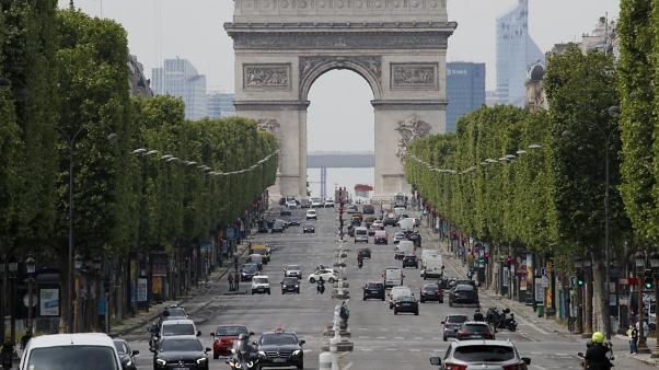 Cars drive on the Champs Elysee avenue in Paris.