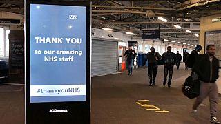 Commuters in London as the lockdown is loosened