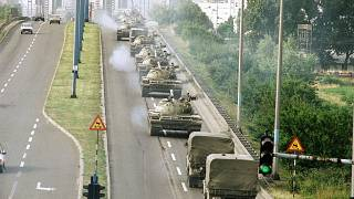 Tanks and jeeps of the Yugoslav Army cross a bridge on way back to the Marshal-Tito-Barracks in Zagreb on Wednesday, July 3, 1991.