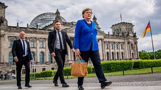 German Chancellor Angela Merkel walks to the Chancellery after the government questioning in the Bundestag in Berlin, Wednesday, May 13