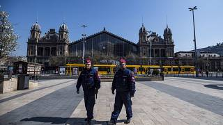 Police officers patrol in central Budapest, Hungary, 3 April, 2020.