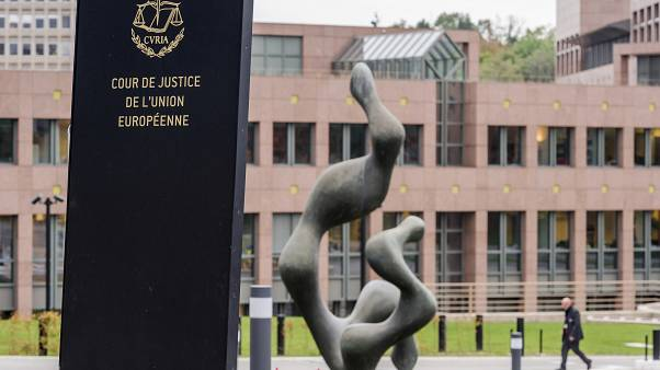 In this Oct. 5, 2015 file photo, a man walks by the European Court of Justice in Luxembourg.