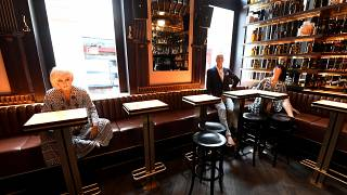 Dummies are placed in a bar in Vienna to help customers keeping the distance on May 14, 2020 amid the novel coronavirus COVID-19 pandemic.