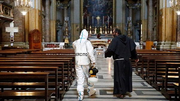 An Italian Army specialist talks with a priest in Rome