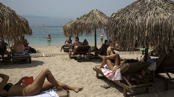 Virus Outbreak Greece Beaches