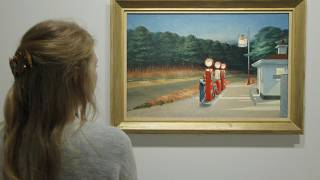 """A woman looks at """"Gas 1940"""" as part of the retrospective of Edward Hopper, one of the great American 20th century artists in 2012."""