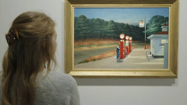 "A woman looks at ""Gas 1940"" as part of the retrospective of Edward Hopper, one of the great American 20th century artists in 2012."