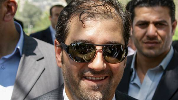 رامي مخلوف مشاركاً في احتفال أقيم بمناسبة الذكرى ��لعاشرة لتسلم الأسد السلطة في دمشق في عام 2010 (أرشيف)