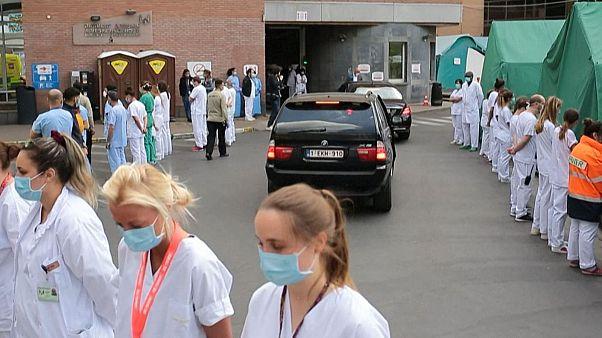 Hospital staff stage silent protest during prime minister visit