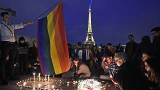 People in Paris pay tribute the victims of a mass shooting at an Orlando gay club, Monday, June 13, 2016.