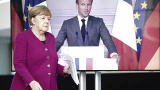 German Chancellor Angela Merkel arrives for a news conference with French President Emmanuel Macron