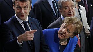 (L-R) French President Emmanuel Macron, German Chancellor Angela Merkel (Photo by Odd ANDERSEN / AFP)