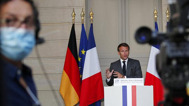 French President Emmanuel Macron speaks during a joint video press conference with German Chancellor Angela Merkel, at the Elysee Palace Monday, May 18, 2020 in Paris