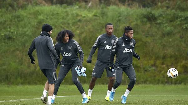 Manchester United players attend a training session