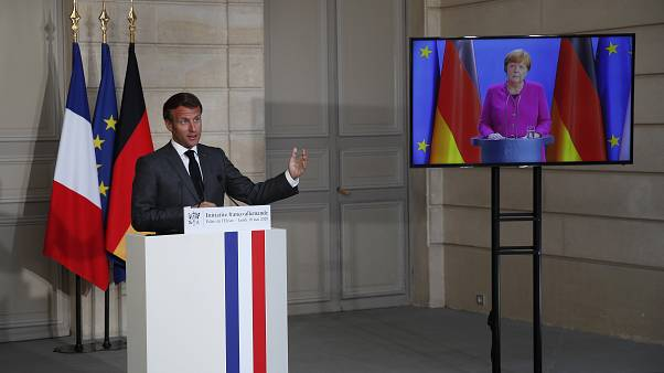 French President Emmanuel Macron speaks while German Chancellor Angela Merkel during a joint press conference on May 18, 2020.