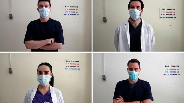 Nikolaos Katsanakis, top left, Ilias Sinanidis, top right, Anna Karagiannakou, bottom left, and Konstantinos Koufatzidis pose at the entrance of the COVID-19 Clinic at Sotiria