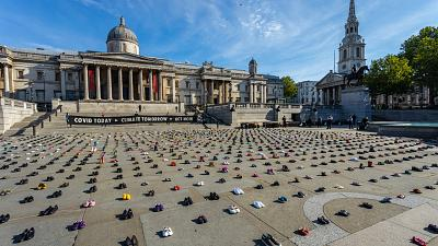 Trafalgar Square, London. Extinction Rebellion cover it with children's shoes in protest against climate change