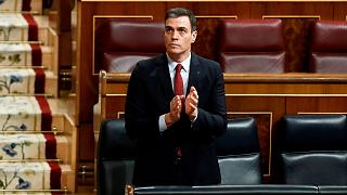 Spain's Prime Minister Pedro Sanchez applauds in parliament before a vote to approve the extension of the national lockdown in Madrid, Spain, Wednesday, March 25, 2020