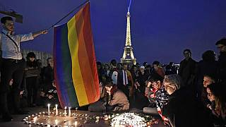 People in Paris pay tribute the victims of a mass shooting at an Orlando gay club, Monday, June 13, 2016.   -   Copyright  AP Photo/Martin Meissner
