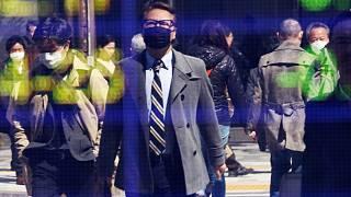 People on a street in Tokyo. March 18, 2020